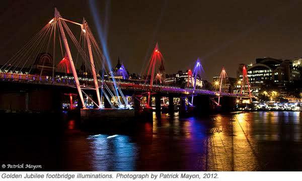 Bridge with neon lights glowing at night