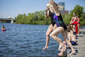 Swimmers jump into Boston's Charles river