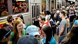 Boston commuters wait for the MBTA train